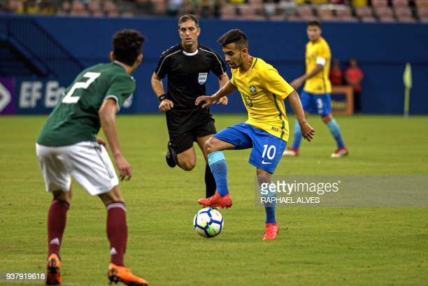 Brazil's midfielder Alan vies for the ball with Mexico's defender Daniel Arteaga during their international friendly Under20 football match in Arena...