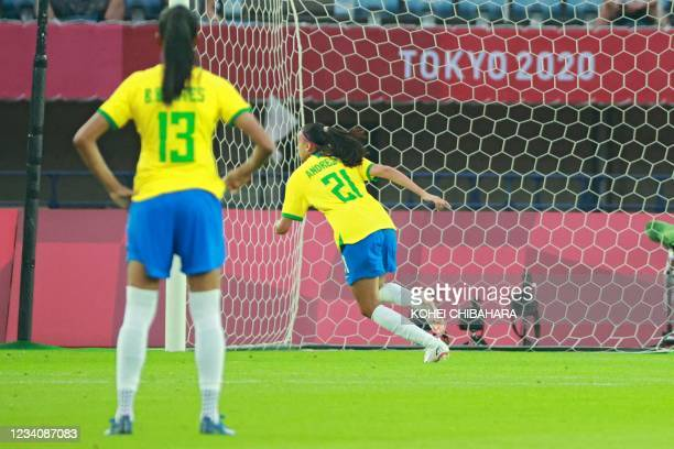 Brazil's midfielder Andressa runs to celebrate after scoring a penalty during the Tokyo 2020 Olympic Games women's group F first round football match...