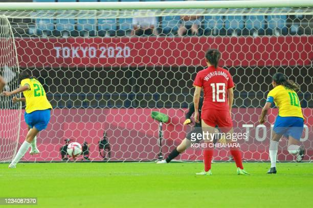 Brazil's midfielder Andressa shoots to score from the penalty spot during the Tokyo 2020 Olympic Games women's group F first round football match...
