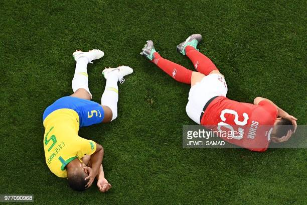 TOPSHOT Brazil's midfielder Casemiro and Switzerland's defender Fabian Schaer react after a shock during the Russia 2018 World Cup Group E football...