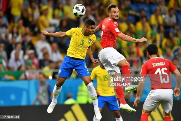 TOPSHOT Brazil's midfielder Casemiro and Switzerland's forward Haris Seferovic compete for the ball during the Russia 2018 World Cup Group E football...