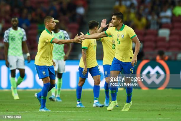 Brazil's midfielder Casemiro celebrates after scoring an equaliser during an international friendly football match between Brazil and Nigeria at the...