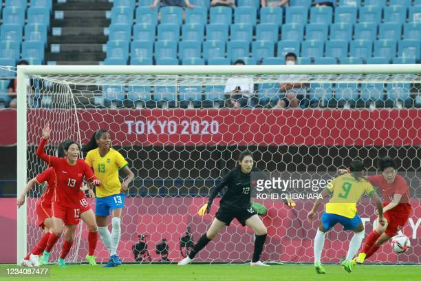 Brazil's midfielder Debinha prepares to shoot during the Tokyo 2020 Olympic Games women's group F first round football match between China and Brazil...