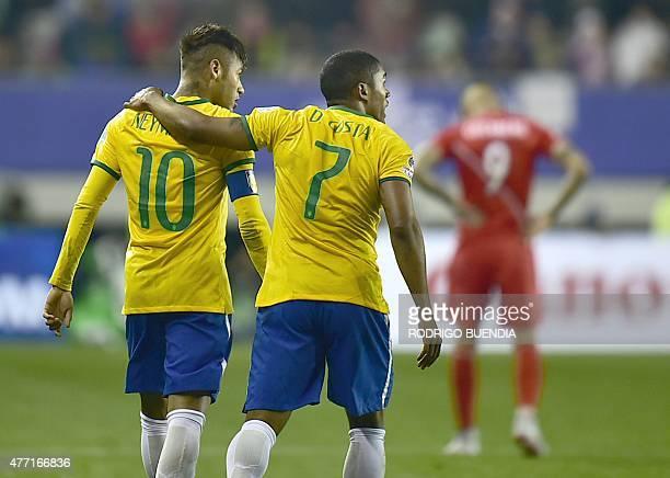 Brazil's midfielder Douglas Costa celebrates with teammate Neymar after scoring against Peru during their 2015 Copa America football championship...