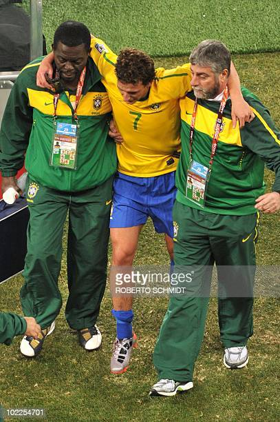 Brazil's midfielder Elano is evecuate dfrom the pitch during Group G first round 2010 World Cup football match Brazil vs Ivory Coast on June 20 2010...