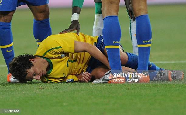 Brazil's midfielder Elano lies on the ground after being tackled during the Group G first round 2010 World Cup football match Brazil vs Ivory Coast...