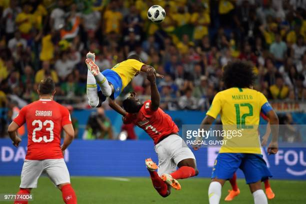 TOPSHOT Brazil's midfielder Fernandinho and Switzerland's forward Breel Embolo compete for the ball during the Russia 2018 World Cup Group E football...