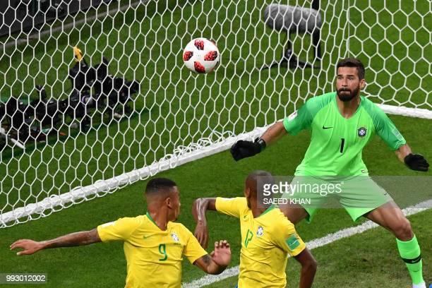 Brazil's midfielder Fernandinho looks at the ball after scoring an owngoal during the Russia 2018 World Cup quarterfinal football match between...