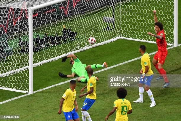 TOPSHOT Brazil's midfielder Fernandinho looks at the ball after scoring an owngoal during the Russia 2018 World Cup quarterfinal football match...