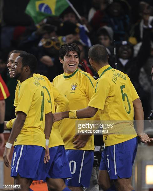 Brazil's midfielder Kaka celebrates with Brazil's midfielder Felipe Melo after Brazil's midfielder Elano scored during the Group G first round 2010...