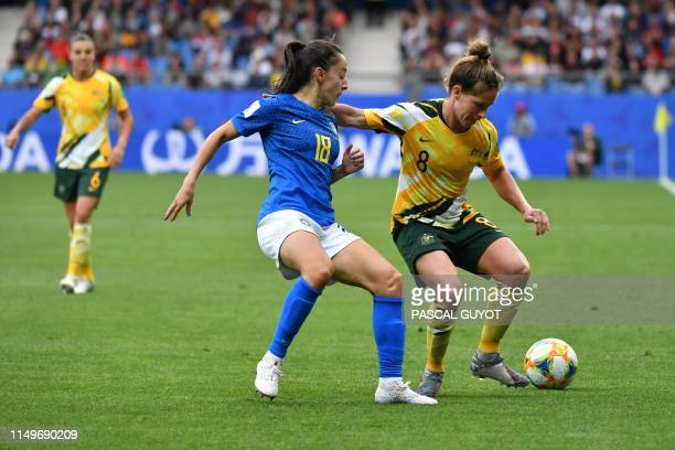 Brazil's midfielder Luana Paixao vies for the ball with Australia's midfielder Elise KellondKnight during the France 2019 Women's World Cup Group C...