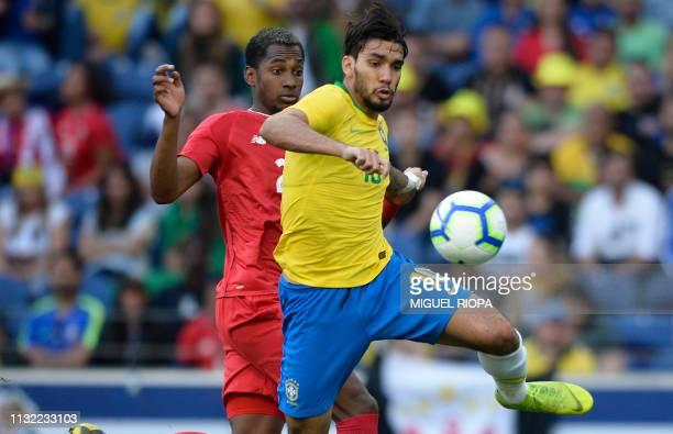 Brazil's midfielder Lucas Paqueta controls the ball next to Panama's defender Michael Amir Murillo during an international friendly football match...