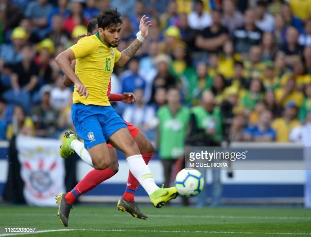 Brazil's midfielder Lucas Paqueta kicks the ball to score a goal during an international friendly football match between Brazil and Panama at the...