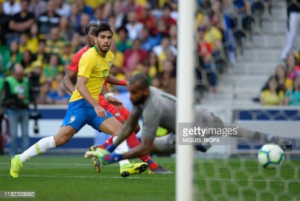 Brazil's midfielder Lucas Paqueta scores a goal during an international friendly football match between Brazil and Panama at the Dragao stadium in...