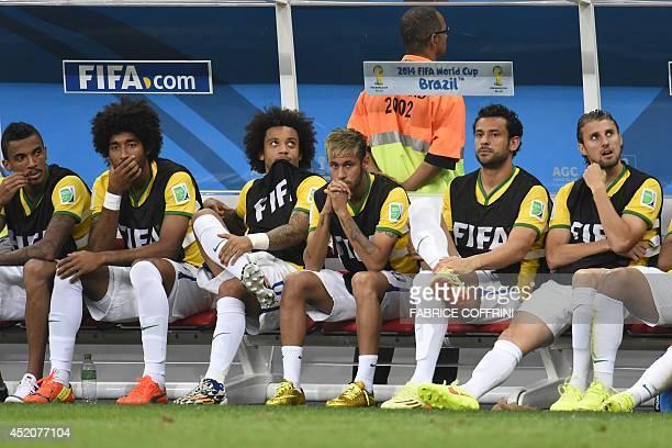 Brazil's midfielder Luiz Gustavo Brazil's defender Dante Brazil's defender Marcelo Brazil's injured forward Neymar Brazil's forward Fred and Brazil's...