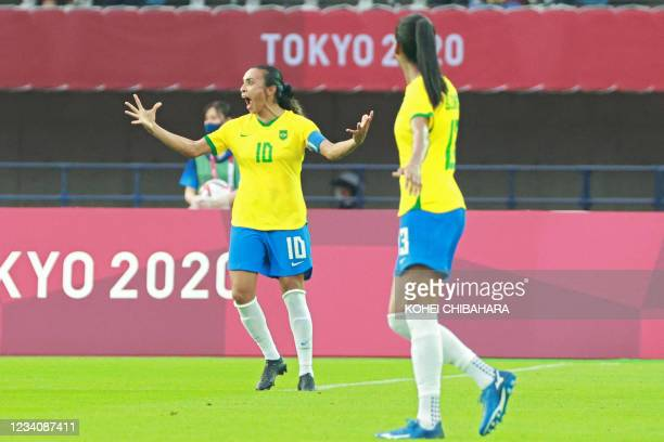 Brazil's midfielder Marta celebrates after scoring her second goal, team's third, during the Tokyo 2020 Olympic Games women's group F first round...