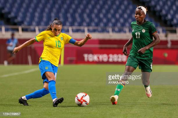 Brazil's midfielder Marta fights for the ball with Zambia's midfielder Racheal Kundananji during the Tokyo 2020 Olympic Games women's group F first...