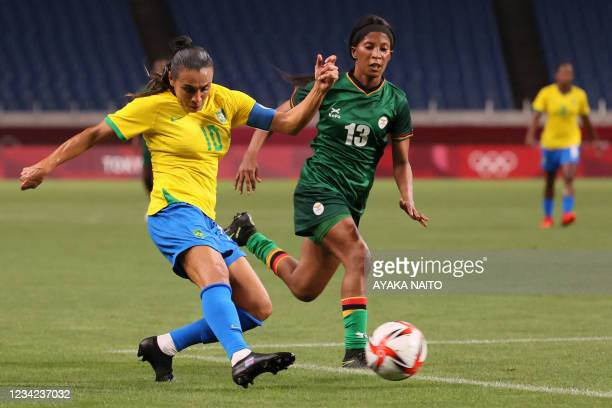 Brazil's midfielder Marta shoots the ball next to Zambia's defender Martha Tembo during the Tokyo 2020 Olympic Games women's group F first round...