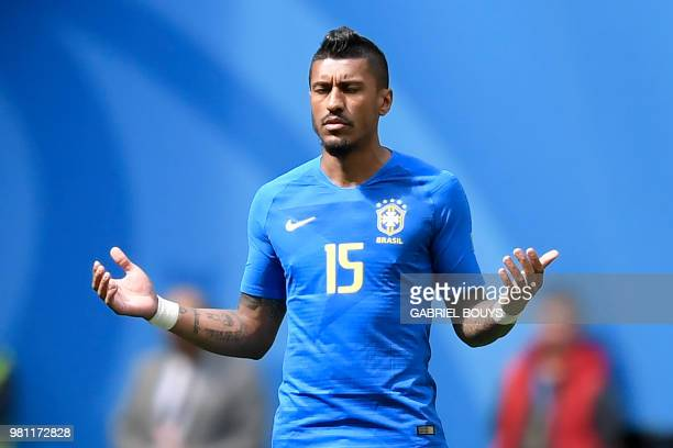 Brazil's midfielder Paulinho prays before the Russia 2018 World Cup Group E football match between Brazil and Costa Rica at the Saint Petersburg...