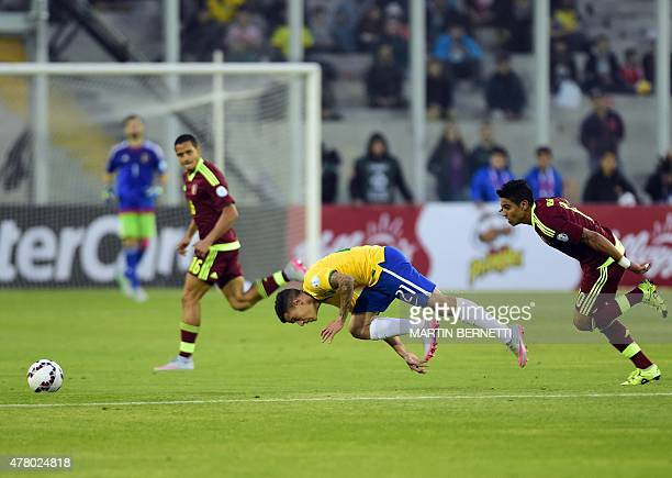 Brazil's midfielder Philippe Coutinho falls in front of Venezuela's midfielder Ronald Vargas during the 2015 Copa America football championship match...