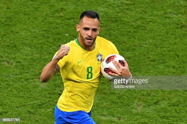 Brazil's midfielder Renato Augusto celebrates scoring a goal during the Russia 2018 World Cup quarterfinal football match between Brazil and Belgium...