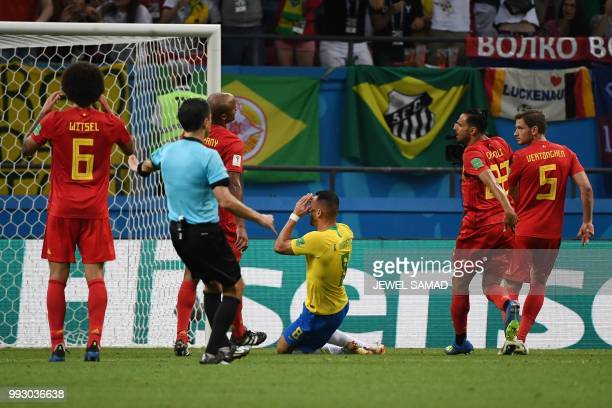 Brazil's midfielder Renato Augusto reacts after missing shot during the Russia 2018 World Cup quarterfinal football match between Brazil and Belgium...