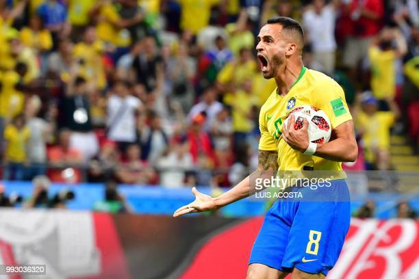 Brazil's midfielder Renato Augusto reacts after scoring his team's first goal during the Russia 2018 World Cup quarterfinal football match between...