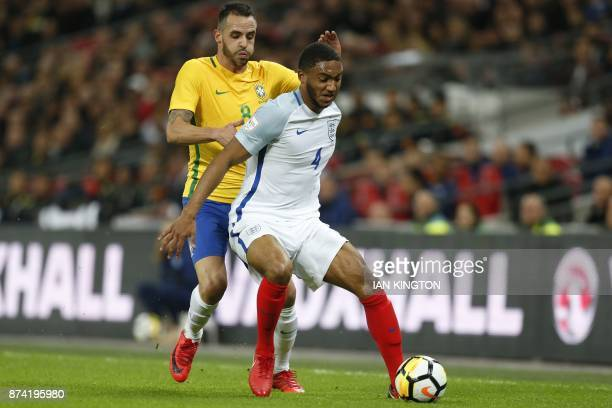 Brazil's midfielder Renato Augusto vies with England's defender Joe Gomez during the international friendly football match between England and Brazil...