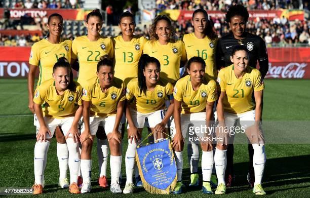 Brazil's midfielder Rosana midfielder Darlene defender Poliana defender Monica and goalkeeper Luciana Brazil's midfielder Andressa defender Tamires...