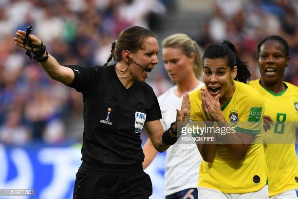 TOPSHOT Brazil's midfielder Thaisa argues with Canadian referee MarieSoleil Beaudoin during the France 2019 Women's World Cup round of sixteen...