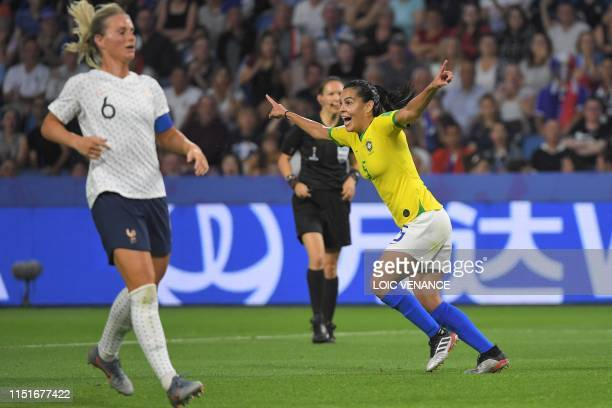 TOPSHOT Brazil's midfielder Thaisa celebrates after scoring a goal during the France 2019 Women's World Cup round of sixteen football match between...