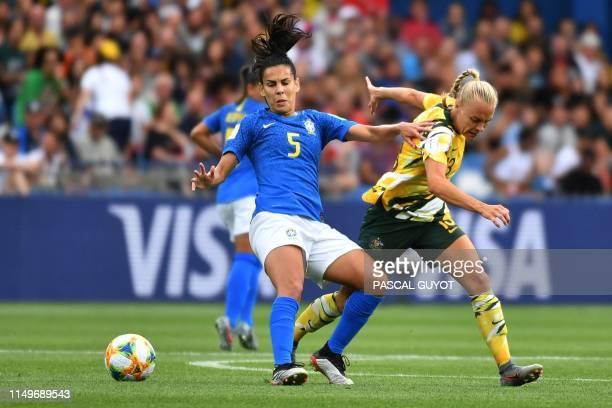 Brazil's midfielder Thaisa vies for the ball with Australia's midfielder Tameka Yallop during the France 2019 Women's World Cup Group C football...