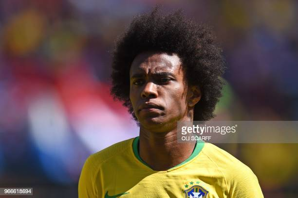 Brazil's midfielder Willian lines up for the anthems ahead of the International friendly football match between Brazil and Croatia at Anfield in...