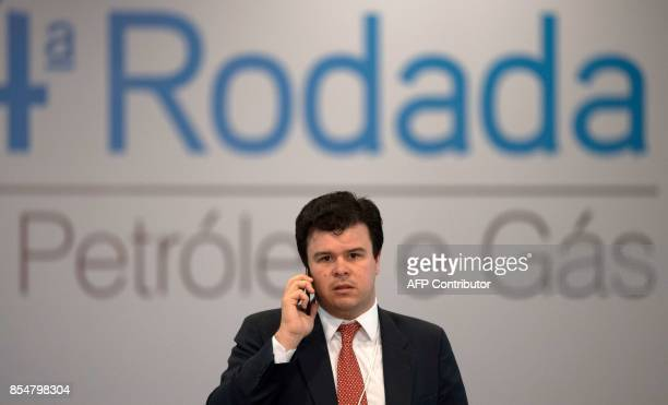 Brazil's Minster of Mines and Energy Fernando Coelho Filho speaks on his mobile phone during a press conference after the National Petroleum Agency...