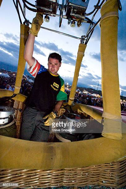 Brazil's Mr Scarecrow Pilot Eduardo Melo assesses the weather conditions before launch on Day 8 of the 2008 Albuquerque International Balloon Fiesta...