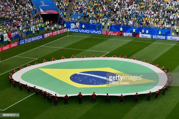 Brazil's national flag is carried during the Russia 2018 World Cup round of 16 football match between Brazil and Mexico at the Samara Arena in Samara...