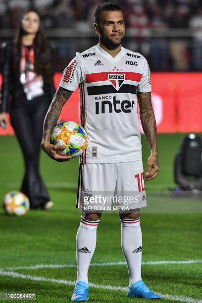 Brazil's national football team captain Dani Alves show the jersey of his new team Sao Paulo, during his official presentation, at Morumbi stadium in...