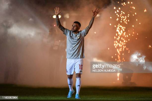Brazil's national football team captain Dani Alves, waves to supporters during his official presentation in his new team Sao Paulo FC, at Morumbi...