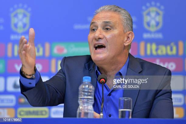 Brazil's national football team coach Tite speaks during a press conference to announce his squad of players for the upcoming friendly matches...