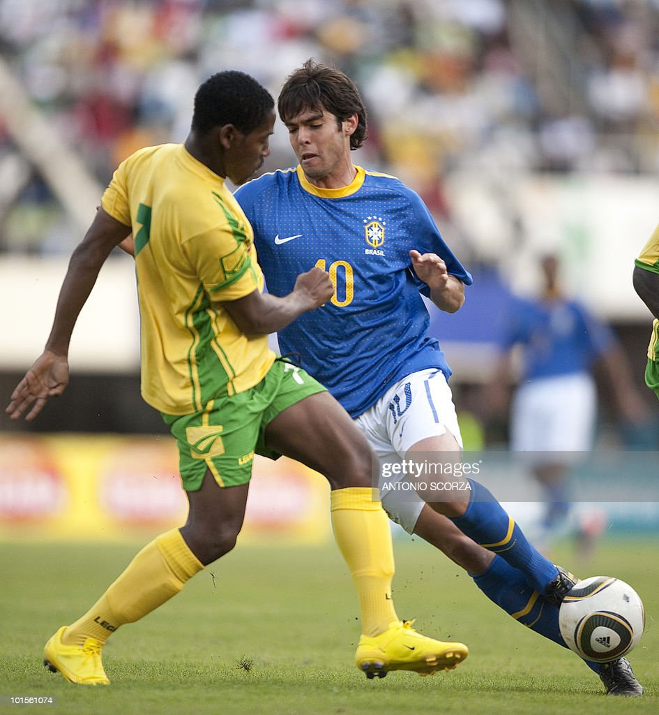 Brazil's national football team forward Kaka (R) fights for the ball with Zimbabwe's Method Mwanjali on June 2, 2010 during a friendly football match against Zimbabwe at the National Sport Stadium in Harare. The Brazilian national team is preparing for the 2010 FIFA World Cup in South Africa.