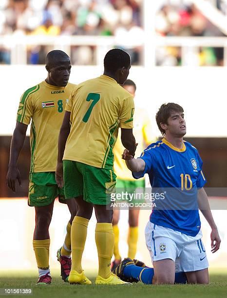 Brazil's national football team forward Kaka is helped by Zimbabwe's defender Method Mwanjali and midfielder Tinashe Nengomasha on June 2 2010 during...