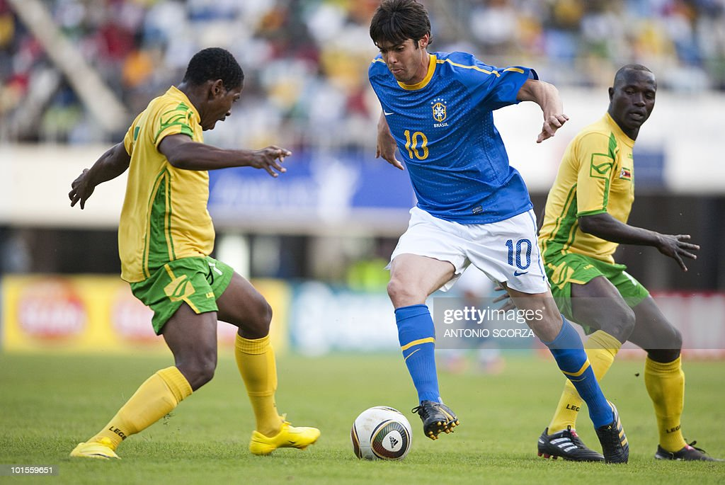Brazil's national football team forward Kaka try to avoid Zimbabwe's Method (L) and Quincy (R) on June 2, 2010 during a friendly football match at the National Sport Stadium in Harare. The Brazilian national team is preparing for the 2010 FIFA World Cup in South Africa.