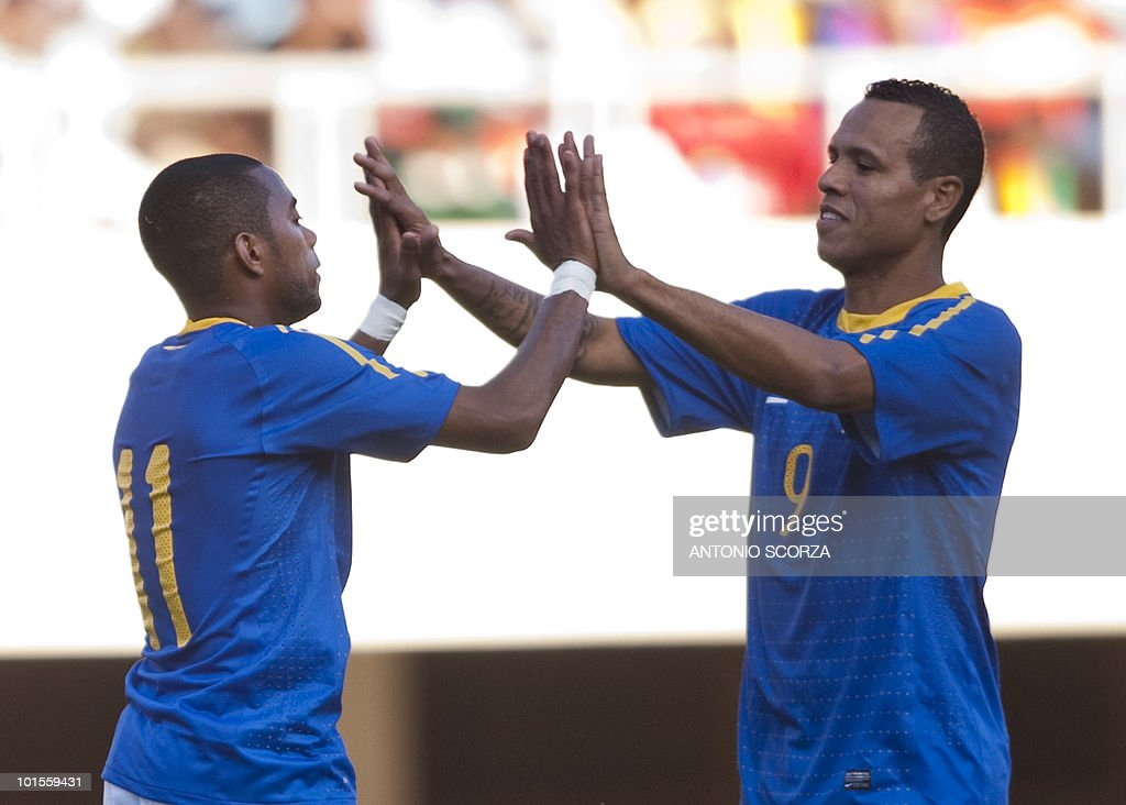 Brazil's national football team forward Robinho (L) celebrates with teammate Luis Fabiano his goal against Zimbabwe at the National Sport Stadium in Harare on June 2, 2010 during a friendly football match. The Brazilian national team is preparing for the 2010 FIFA World Cup in South Africa.
