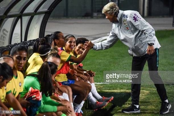 Brazil's national team coach, Pia Sundhage of Sweden, shakes hands with her players before a Torneio Uber tournament football match between Brazil...