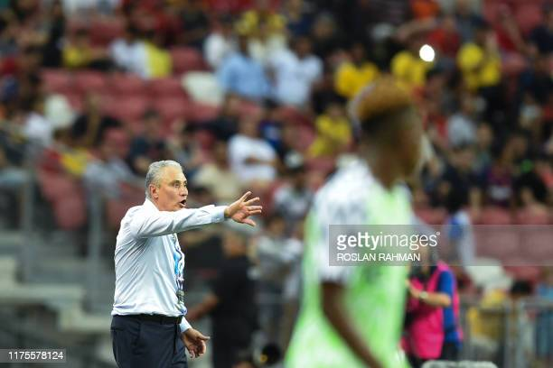 Brazil's national team coach Tite reacts during an international friendly football match between Brazil and Nigeria at the National Stadium in...
