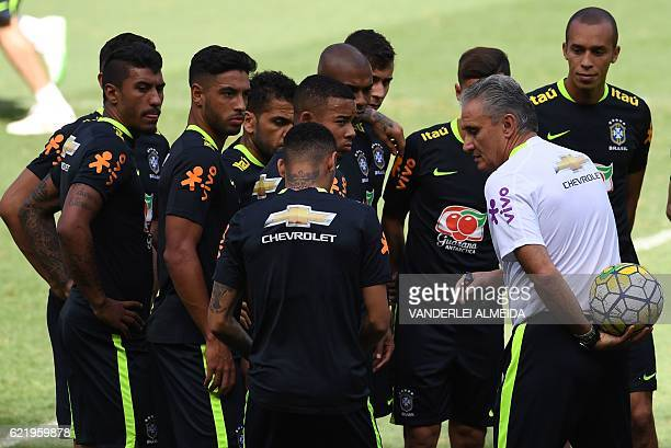 Brazil's national team coach Tite speaks with his players during a training session at Mineirao stadium in Belo Horizonte Minas Gerais Brazil on...