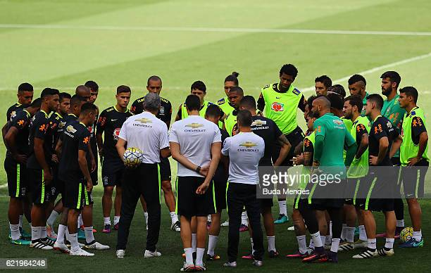 Brazil's national team coach Tite speaks with his players during a training session at Mineirao Stadium on November 9 2016 in Belo Horizonte Brazil