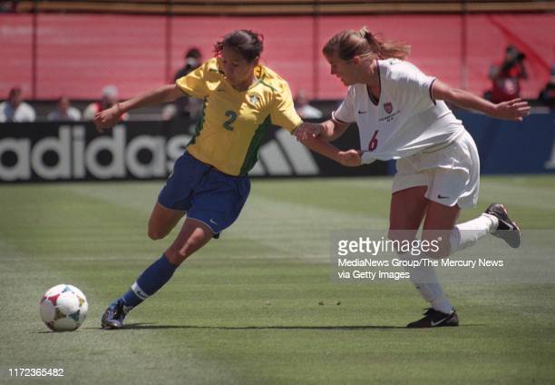 Brazil's Nene holds onto Brandi Chastain's shirt as she protects the ball, during first half action at the Women's World Cup Soccer Semi-finals.