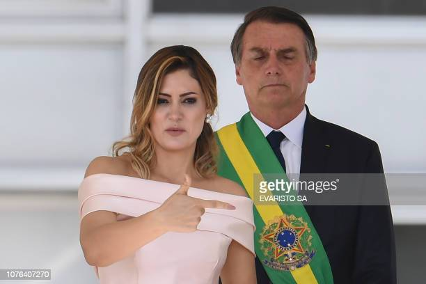 Brazil's new First Lady Michelle Bolsonaro delivers a speech in sign language flanked by his husband Brazil's new president Jair Bolsonaro at...