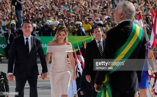 Brazil's new president Jair Bolsonaro his wife Michelle Bolsonaro and Brazil's new VicePresident Hamilton Mourao are welcomed by outgoing Brazilian...